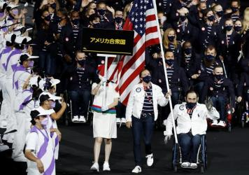 Flag bearers Melissa Stockwell and Charles Aoki of Team USA lead their delegation in the parade of athletes during the opening ceremony of the Tokyo 2020 Paralympic Games on August 24, 2021 in Tokyo, Japan.