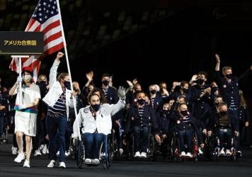 Flag bearers Melissa Stockwell and Charles Aoki of Team United States lead their delegation in the parade of athletes during the opening ceremony of the Tokyo 2020 Paralympic Games.