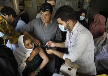 Doctors administer the Johnson & Johnson COVID-19 vaccine to patients at the Wazir Akbar Khan hospital in Kabul, Afghanistan in July.