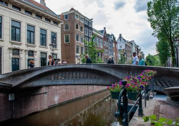The almost 40-foot 3D-printed pedestrian bridge designed by Joris Laarman and built by Dutch robotics company MX3D has been opened in Amsterdam six years after the project was launched. The bridge, which was fabricated from stainless steel rods by six-ax