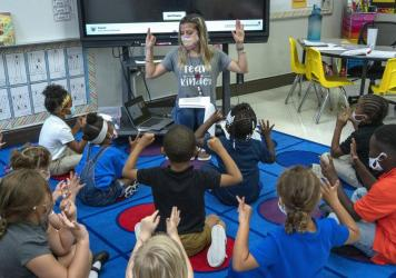 Nashville, Tenn., kindergarten teacher Amber Updegrove leads her class in a lesson this month. On Monday, the U.S. Department of Education announced an investigation into Tennessee's requirement that schools allow families to opt out of mask mandates.