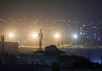 Planes are seen on the tarmac at the airport in Kabul late on August 30, 2021, hours ahead of the U.S. deadline to complete its frenzied withdrawal from Afghanistan.