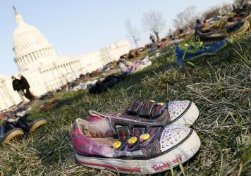 Thousands of empty empty pairs of shoes for every child killed by guns in the U.S. since Sandy Hook cover the southeast lawn of U.S. Capitol on March 13, 2018, in Washington, D.C.