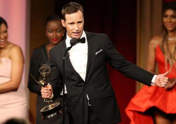 Mike Richards accepts a Daytime Emmy Award for outstanding game show for <em>The Price is Right</em> in 2016.