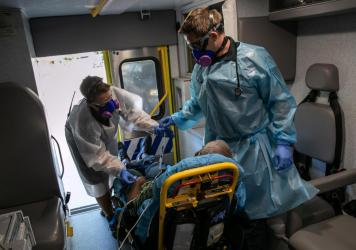 Medics transport a man with COVID-19 symptoms to a hospital in Austin, Texas. More than 3 million people in the state have had COVID-19, but just 81,000 are listed in a central data set at the Centers for Disease Control and Prevention.