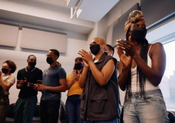 The cast of <em>Hadestown</em> gathered, masked, for their first rehearsal in 17 months. Broadway has strict safety protocols but there has been at least one breakthrough infection in a touring cast.