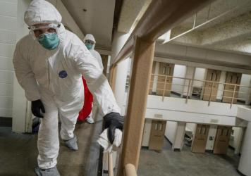 Inmates do a deep cleaning in a cell pod to prevent the spread of COVID-19 at the San Diego County Jail in April 2020. A new study says crowded jails may have contributed to millions of COVID-19 cases across the United States.