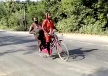 In this screen grab from video posted by BBC News Hindi, 15-year-old Jyoti Kumari rides with her father during their 700-mile journey to their family's village of Sirhulli in eastern India.