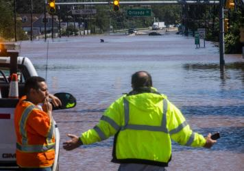 People take a look at the 206 route partially flooded as a result of the remnants of Hurricane Ida in Somerville, N.J., Thursday, Sept. 2, 2021.