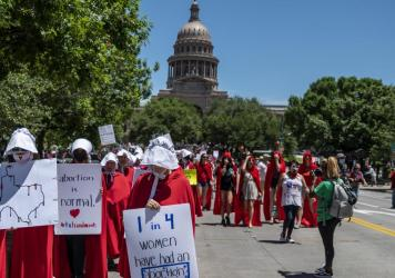 Leaders at two dating-app giants in Texas — Match Group and Bumble — have moved to set up funds to aid people affected by the state's new abortion ban. Here, abortion-rights supporters march near the Texas Capitol in Austin this year.