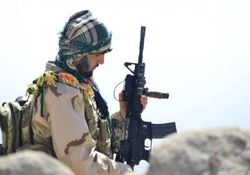An Afghan anti-Taliban fighter is seen on a hilltop in Anaba district in Afghanistan's Panjshir province on Wednesday.