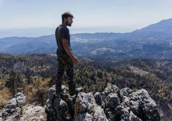 """""""This used to be paradise. Now it's hell,"""" says pine resin producer Giorgos Anagnostou, 38, standing on top of a mountain near his village of Kourkouloi in northern Evia. The fire wiped out the forest's pine trees and his livelihood."""