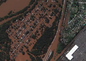 <strong>DURING FLOOD - Sept. 2, 2021:</strong> Overview of flooded homes along Huff Avenue and Railyard in Manville, N.J.