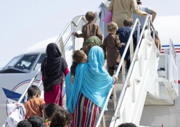 A group of vulnerable Afghans board a domestic United Airlines flight out of Dulles International airport on Aug. 26, 2021. Photo courtesy of United Airlines.