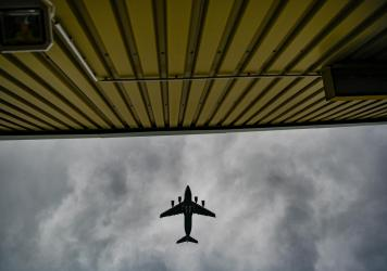 A plane flies over temporary camp for refugees from Afghanistan at the U.S. Army's Rhine Ordnance Barracks (ROB), where they are being temporarily housed, on August 30, 2021 in Kaiserslautern, Germany.