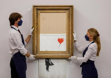 """Banksy's """"Love is in the Bin"""" is installed at Sotheby's on September 03, 2021 in London, England."""