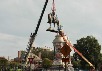 The statue of Confederate Gen. Robert E. Lee is removed from its pedestal Wednesday in Richmond, Va.