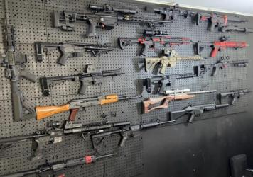 A wall in a gun room in Airmont, N.Y., Deputy Mayor Brian Downey's house held a range of powerful weapons, many of which were not registered, authorities say.