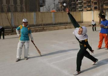 Afghan girls play cricket on school grounds in Kabul in 2010. At the time, Afghanistan was set to select its first national women's cricket team. But a Taliban official now reportedly says women won't be allowed to play it and other sports.