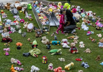 A young girl and her mother visit a temporary art installation, called Bear the Truth, on June 28, 2020, at the Los Angeles City Hall. The installation honors Black children who have lost their lives to racial injustice and senseless violence.
