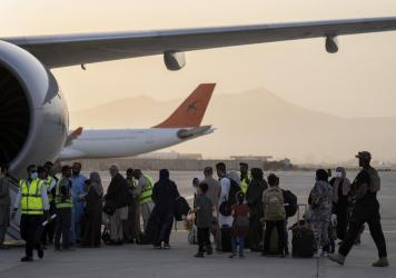 Passengers board a Qatar Airways aircraft at the airport in Kabul, Afghanistan on Thursday.