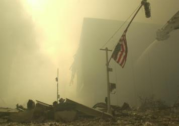 An American flag at ground zero on the evening of Sept. 11, 2001, after the terrorist attacks on the World Trade Center in New York City.