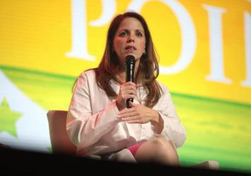 Dr. Simone Gold discourages vaccination against COVID-19 and promotes alternative, unproven therapies. She has spent much of the past year speaking at events like this one held in West Palm Beach, Fla., in December. The conference was aimed at young peop