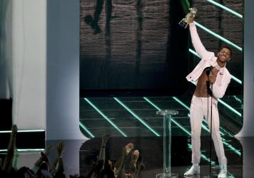 """Lil Nas X accepts best direction for """"Montero (Call Me by Your Name)"""" onstage during the 2021 MTV Video Music Awards on Sunday in New York City."""