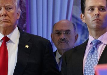 Allen Weisselberg (center), the longtime chief financial officer of former President Donald Trump's family business, stands behind Trump and Donald Trump Jr. during a 2017 news conference at Trump Tower in New York City.