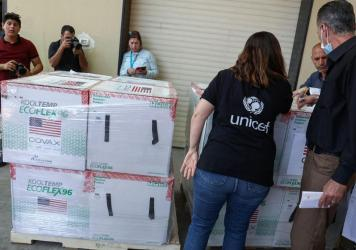 Palestinian Health Ministry staff members in Nablus receive 300,000 doses of COVID-19 vaccines donated by the United States through through the COVAX vaccine-sharing initiative on Aug. 24, 2021.