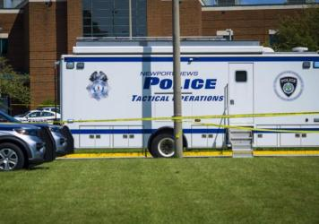 Police respond to the scene of a shooting at Heritage High School in Newport News, Va., on Sept. 20, 2021.