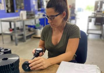 Nicole Wolter at work at her factory in Wauconda, Ill., which makes components for industrial machines. Wolter's company is straining to meet demand as her own suppliers struggle with short staffing.
