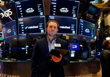 Traders work on the floor at the New York Stock Exchange this summer. Members of Congress are required to disclose their stock transactions under a law known as the STOCK Act, but an outside ethics group filed complaints, noting that some lawmakers are v