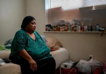Wilma Banks, who lives in the neighborhood of New Orleans East, sits on her bed next to her nebulizer and CPAP machine. In the aftermath of Hurricane Ida, when much of New Orleans was left without power, she wasn't able to power up the medical devices an