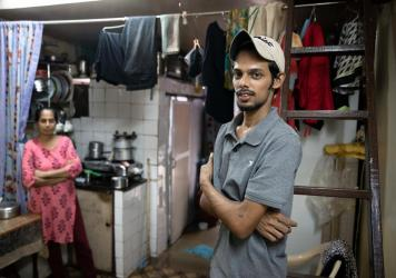 Salman Khan Rashid, 24, right, and his mother, Sana Rashid, at home. Salman lost his job as a golf coach at a Mumbai sports club during the pandemic. The household, which includes Salman's three sisters, is now surviving on savings. But when he's able, h