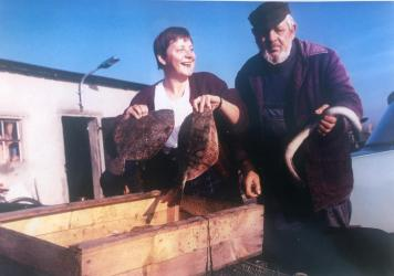 A picture that Hans-Joachim Bull has showing Merkel with his father in 1990.