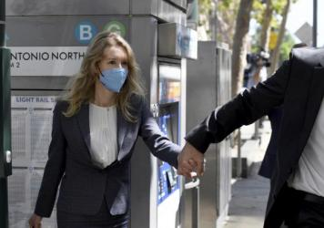 Elizabeth Holmes leaves the federal courthouse in San Jose, Calif., on Sept. 8.
