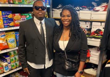 Rapper Gunna and Goodr CEO Jasmine Crowe pose for a photo in the first ever Goodr grocery store at an Atlanta middle school he formerly attended.