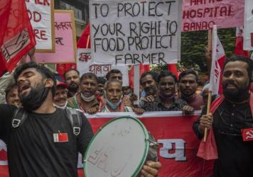 Members of Communist Party of India shout slogans during a protest against farm laws in Mumbai, India Monday, Sept. 27, 2021. The farmers called for a nation-wide strike Monday to mark one year since the legislation was passed, marking a return to protes
