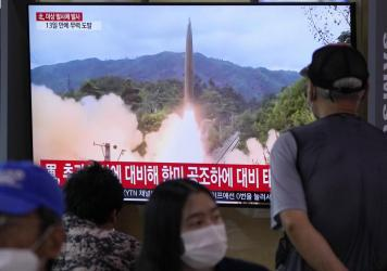 People watch a TV showing a file image of North Korea's missile launch during a news program at the Seoul Railway Station in Seoul, South Korea, Tuesday, Sept. 28. North Korea on Tuesday fired a suspected ballistic missile into the sea, Seoul and Tokyo o