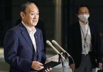 Japanese Prime Minister Yoshihide Suga speaks to reporters about lifting of a state of emergency at his official residence in Tokyo Monday, Sept. 27. Suga announced Tuesday a lifting of the ongoing coronavirus state of emergency and less-stringent measur