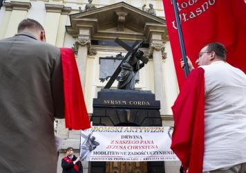 Catholics gathered in front of Warsaw's church of Holy Cross in an anti-LGBT protest in May.