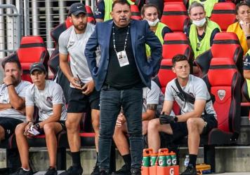 Coach Richie Burke of the Washington Spirit watches the play during a game against the North Carolina Courage at Audi Field on July 10, 2021 in Washington, DC.