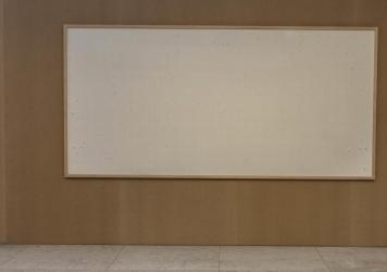 """Jens Haaning's artwork """"Take the Money and Run"""" is seen in the Kunsten Musem of Modern Art. The empty canvas was meant to hold thousands of dollars in cash — but the artist chose to hang on to the money."""