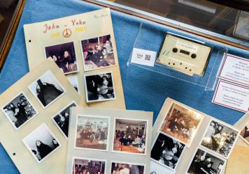 A cassette with the recording of teenage journalists' 1970 interview with John Lennon and Yoko Ono, along with polaroid photos from the conversation, seen at Bruun Rasmussen Auction House in Copenhagen on September 24, 2021. An unidentified bidder won th