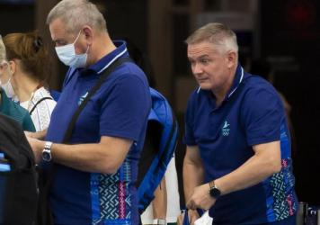 Belarus track coaches Artur Shimak (left) and Yury Maisevich are now under investigation, Olympics officials announced on Thursday. The pair are seen here last month at a checkpoint at a Tokyo airport.