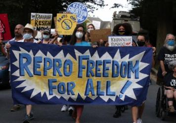 Abortion-rights advocates march to the house of Supreme Court Justice Brett Kavanaugh for a protest on Sept. 13 in Chevy Chase, Md.