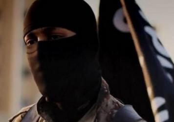 A photo provided by the FBI depicts a masked militant from an ISIS propaganda video from 2014. The individual pictured has allegedly been identified as Mohammed Khalifa.