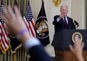 President Joe Biden takes questions after delivering remarks on the debt ceiling at the White House on Oct. 4, 2021.