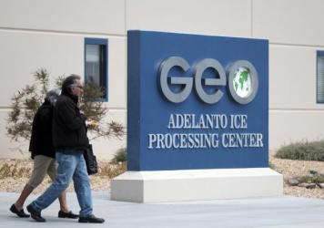 This April 20, 2019, file photo shows the U.S. Immigration and Enforcement Processing Center operated by GEO Group, Inc. (GEO) a Florida-based company specializing in privatized corrections in Adelanto, Calif.